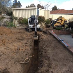 photo mini digger and excavator canberra